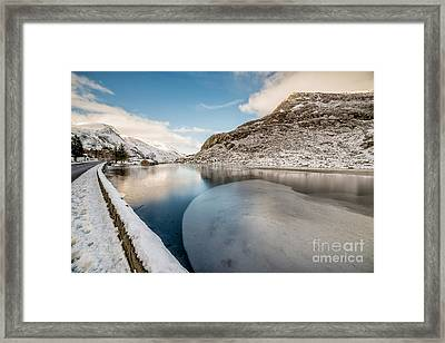 Ice Curve Framed Print by Adrian Evans