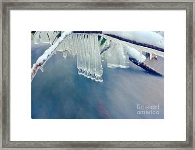 Ice Drops Over Stream Framed Print by Dan Friend