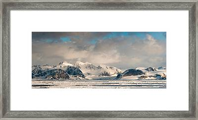 Ice Floes And Storm Clouds In The High Framed Print by Panoramic Images