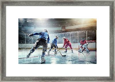 Ice Hockey Players In Action Framed Print by Dmytro Aksonov