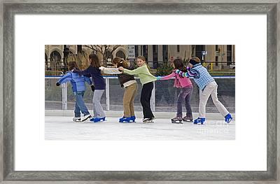 Ice Skaters Framed Print