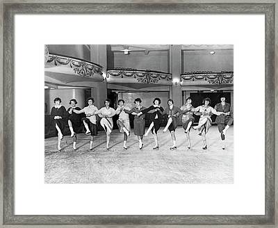 Ice Skating Ballet Troupe Framed Print by Underwood Archives