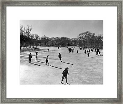 Ice Skating In Wisconsin Framed Print by Underwood Archives