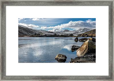 Iced Over Framed Print by Adrian Evans
