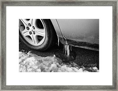 icicle formation on the wheel arch and door of a car Saskatoon Saskatchewan Canada Framed Print by Joe Fox