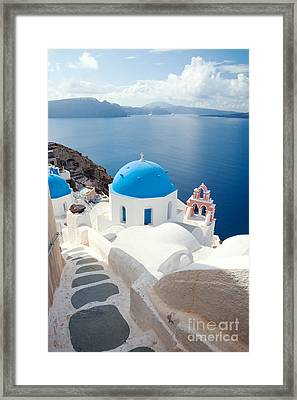 Iconic Blue Domed Churches In Santorini - Greece Framed Print