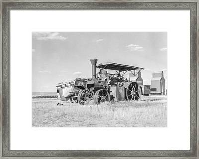 Idle Threshing With Empty Elevators In The Background Framed Print