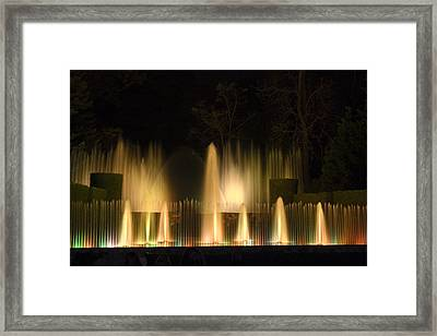 Illuminated Dancing Fountains Framed Print by Sally Weigand