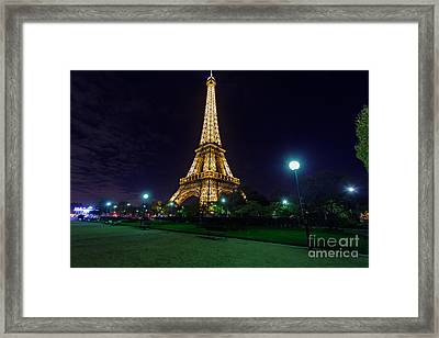 Illuminated Eiffel Tower At Midnight Framed Print by Rostislav Bychkov