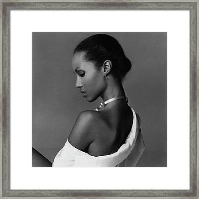 Iman Wearing A Necklace Framed Print by Francesco Scavullo