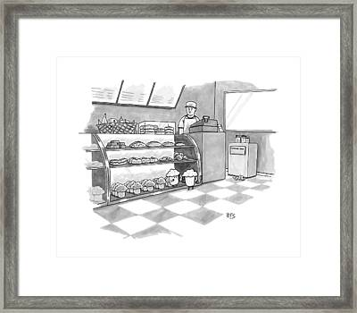 In A Bakery Framed Print