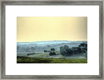 In A Misty Hollow Framed Print