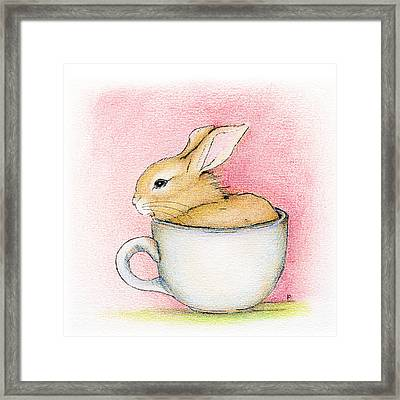 In A Tea Cup Framed Print