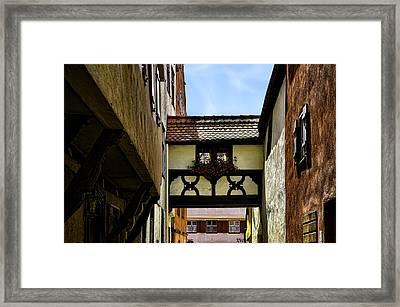 In Between Framed Print by Joanna Madloch