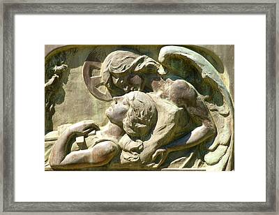 In The Arms Framed Print
