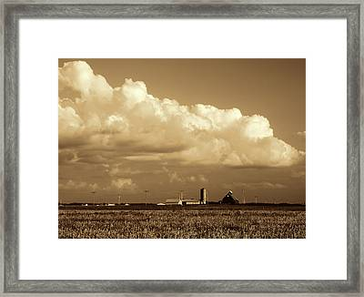 In The Clouds Framed Print by Tom Druin
