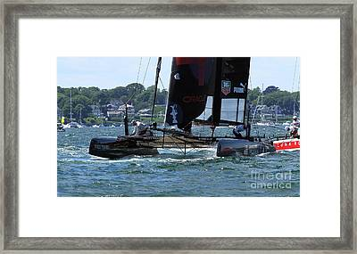In The Lead Framed Print by Butch Lombardi