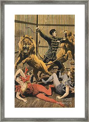 In The Lion�s Cage 1910s Uk Lion Tamers Framed Print by The Advertising Archives