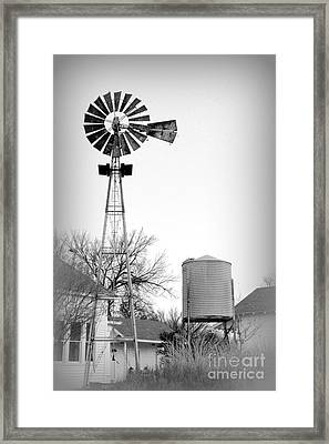 In The Windmills Of Your Mind Framed Print by Kathy  White