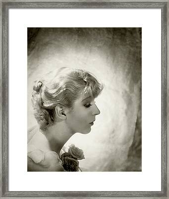 Ina Claire Holding Roses Framed Print