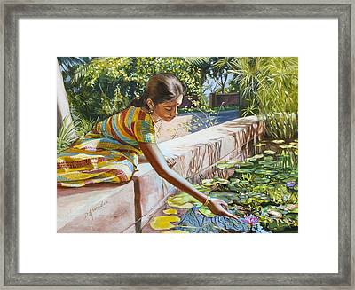 Indian Girl Near The Waterlilies  Framed Print by Dominique Amendola
