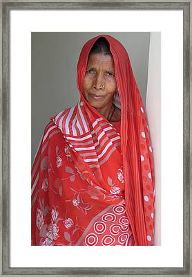 Indian Women In Red Framed Print by Russell Smidt