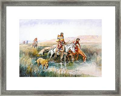 Indian Women Moving Camp Framed Print by Charles Russell