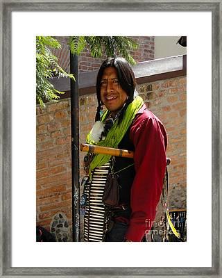 Indigenous Flute Player Framed Print by Al Bourassa