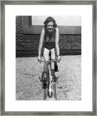 Indoor Stationary Bike Race Framed Print by Underwood Archives