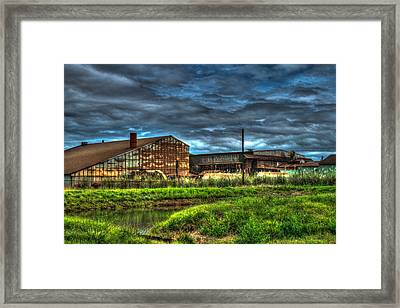 Industrial Complex With Angry Sky Framed Print by Douglas Barnett