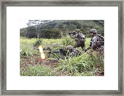 Infantryman Fires A Burst Framed Print by Stocktrek Images