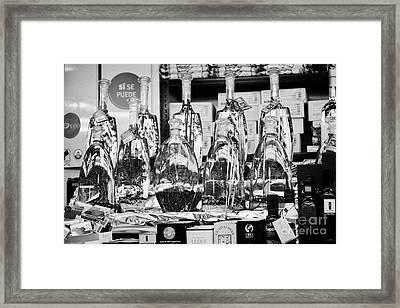 infused olive oils inside the la boqueria market in Barcelona Catalonia Spain Framed Print by Joe Fox