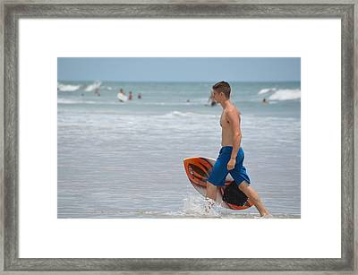 Inland Skimboarder In The Surf Framed Print