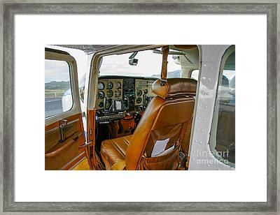 inside a small Cesna Framed Print by Patricia Hofmeester