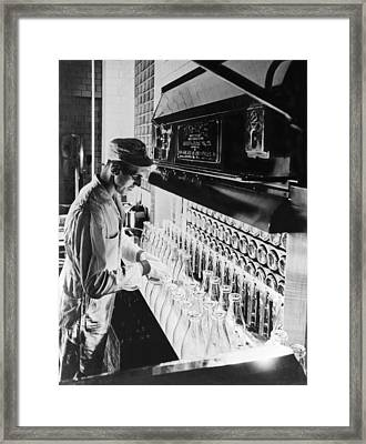 Inspecting Milk Bottles Framed Print