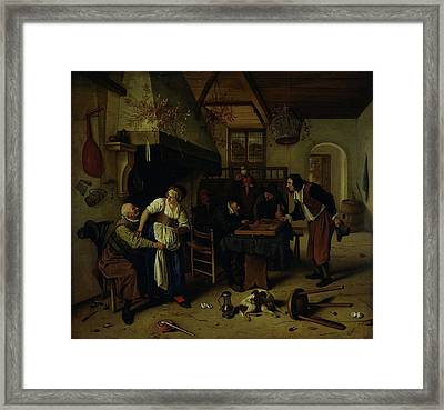 Interior Of An Inn With An Old Man Amusing Himself Framed Print