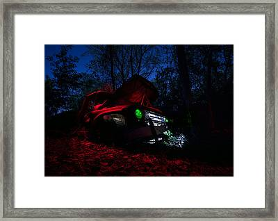 International At Night Framed Print by Cale Best