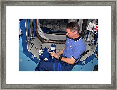 International Space Station Air Sampling Framed Print by Nasa