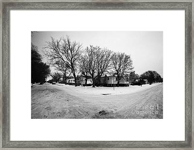 intersection of snow covered residential streets Saskatoon pleasant hill Saskatchewan Canada Framed Print by Joe Fox