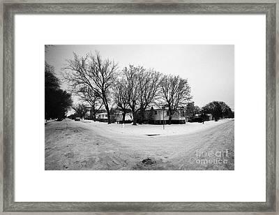 intersection of snow covered residential streets Saskatoon pleasant hill Saskatchewan Canada Framed Print by Joe Fox