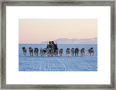 Inuit Hunters And Dog Sled Team Framed Print by Cristina Mittermeier