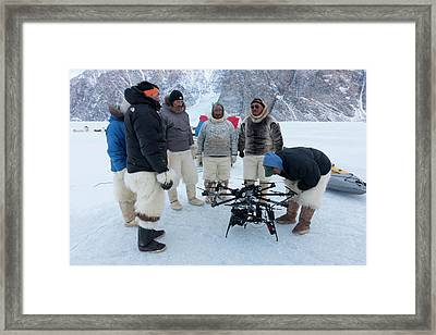 Inuit Hunters With Octocopter Drone Framed Print