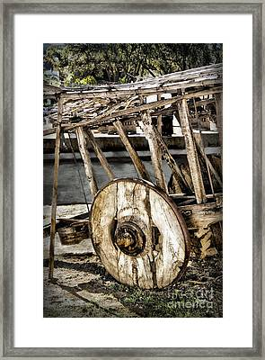 Inventing The Wheel Framed Print