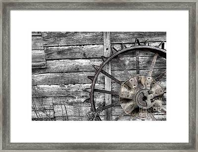 Iron Tractor Wheel Framed Print