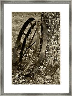 Iron Wheel Framed Print by Linda Segerson