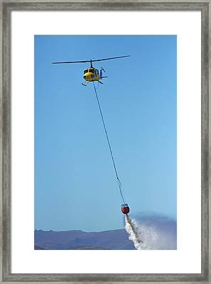 Iroquois Helicopter With Monsoon Framed Print by David Wall