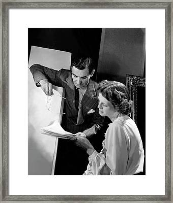 Irving Berlin Looking At Papers With His Wife Framed Print