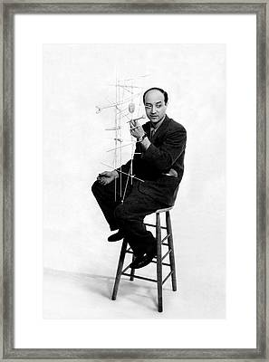Isamu Noguchi Holding One Of His Structures Framed Print
