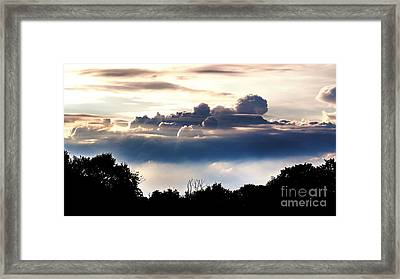 Island Of Clouds Framed Print by Daniel Heine