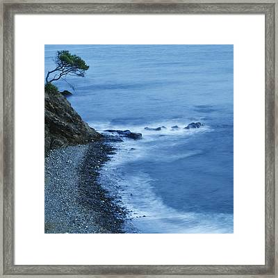 Isolated Tree On A Cliff Overlooking A Framed Print by Ken Welsh